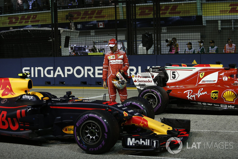 Pole sitter Sebastian Vettel, Ferrari celebrates and observes the cars in parc ferme