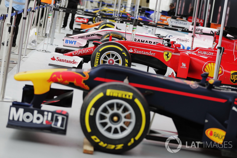 A line-up of Formula 1 cars ahead of the London street demonstration, including a Red Bull Racing, Ferrari, Force India, Williams, McLaren, Sauber, Renault Sport F1 Team and Scuderia Toro Rosso