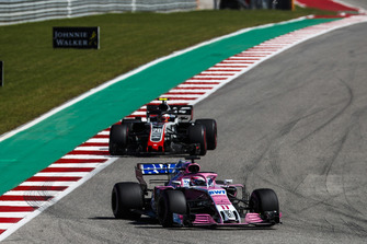 Sergio Perez, Racing Point Force India VJM11, leads Kevin Magnussen, Haas F1 Team VF-18