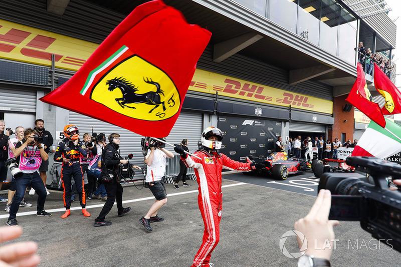 Sebastian Vettel, Ferrari, celebrates victory in parc ferme, as Max Verstappen, Red Bull Racing, looks on