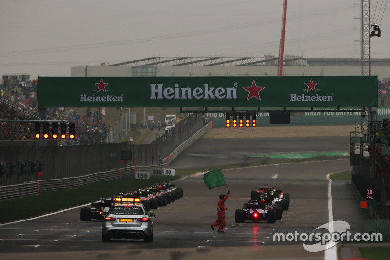 The drivers line up for the start and wait for the lights to go out