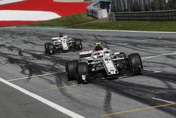 Charles Leclerc, Sauber C37 and Marcus Ericsson, Sauber C37 cross the line