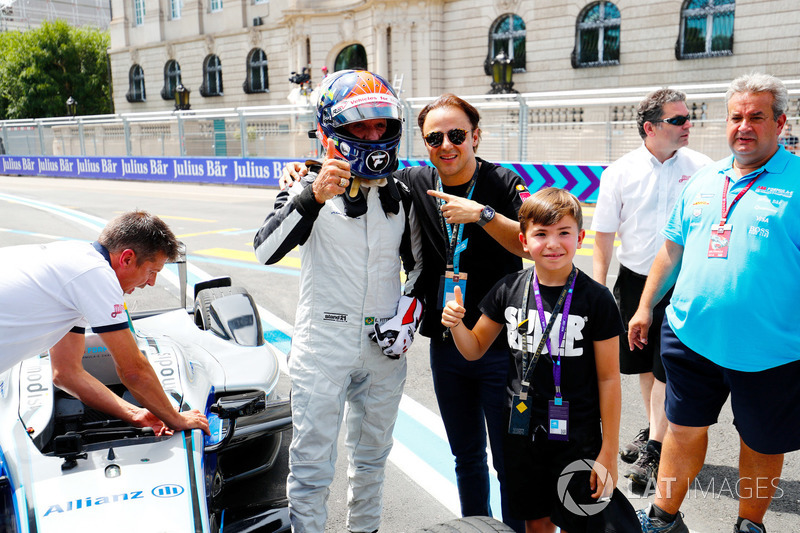 Emerson Fittipaldi, former F1 World Champion, Indy 500 winner, drives the Formula E car, with Felipe