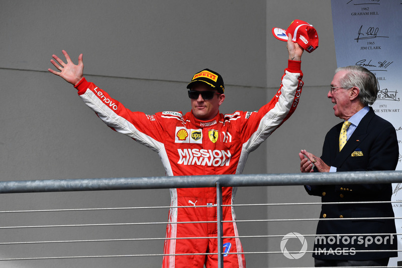 Race winner Kimi Raikkonen, Ferrari celebrates on the podium