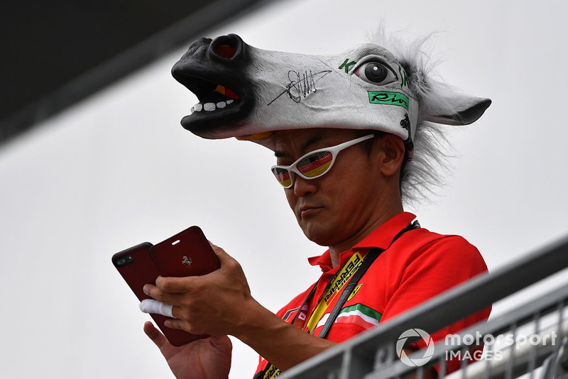 Sebastian Vettel, Ferrari fan with horses head hat at