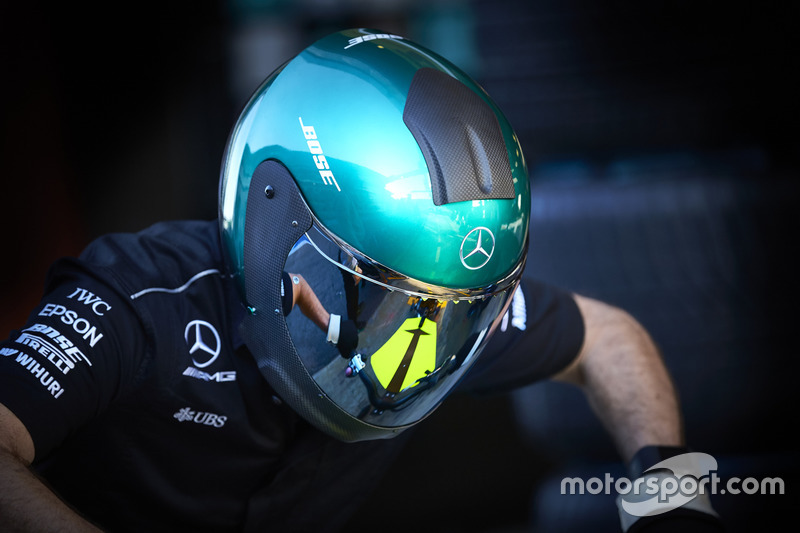 A Mercedes pit crew member at work