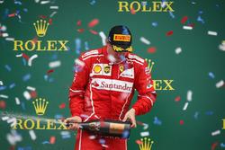 Kimi Raikkonen, Ferrari celebrates on the podium, the champagne