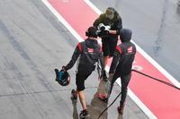 Romain Grosjean, Haas F1 Team walks in after crashing in Q1