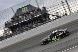 Kurt Busch, Stewart-Haas Racing Ford races past the Monster Energy hospitality