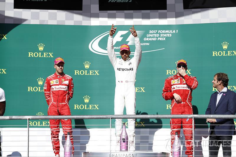 Race winner Lewis Hamilton, Mercedes AMG F1, second place Sebastian Vettel, Ferrari and third place Kimi Raikkonen, Ferrari
