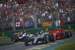 Lewis Hamilton, Mercedes AMG F1 W09, leads Kimi Raikkonen, Ferrari SF71H, Sebastian Vettel, Ferrari SF71H, Kevin Magnussen, Haas F1 Team VF-18 Ferrari, Max Verstappen, Red Bull Racing RB14 Tag Heuer, and Romain Grosjean, Haas F1 Team VF-18 Ferrari, at the start