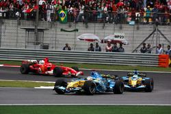 Fernando Alonso, Renault R26 leads Giancarlo Fisichella, Renault R26 and Michael Schumacher, Ferrari 248 F1