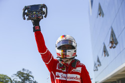 Race winner Sebastian Vettel, Ferrari, celebrates in Parc Ferme, with his steering wheel in his hand