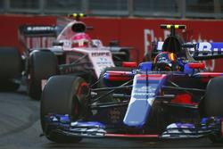 Carlos Sainz Jr., Scuderia Toro Rosso STR12, leads Esteban Ocon, Force India VJM10