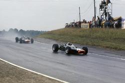 Jackie Stewart, B.R.M. P83, leads Mike Spence, B.R.M. P83