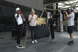 Lewis Hamilton, Mercedes AMG F1, on stage with a lasso