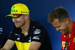 Nico Hulkenberg, Renault Sport F1 Team, and Sebastian Vettel, Ferrari, in the Press conference