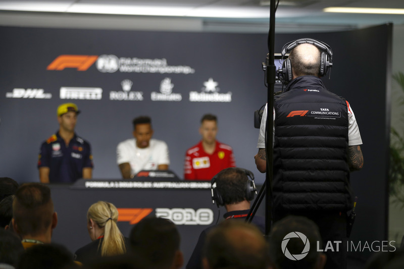 A TV Cameraman records Daniel Ricciardo, Red Bull Racing, Lewis Hamilton, Mercedes AMG F1, and Sebastian Vettel, Ferrari, in the Thursday drivers Press Conference