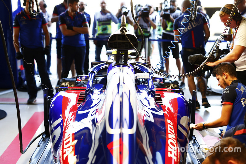 Engineers work on the car of Pierre Gasly, Toro Rosso STR13