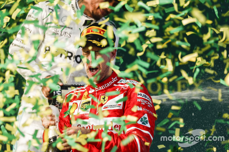 Confetti falls as Sebastian Vettel, Ferrari, 1st Position, celebrates