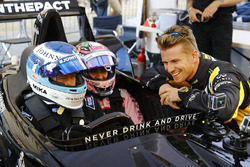 Mika Hakkinen takes Sergio Perez, Force India, forn a ride