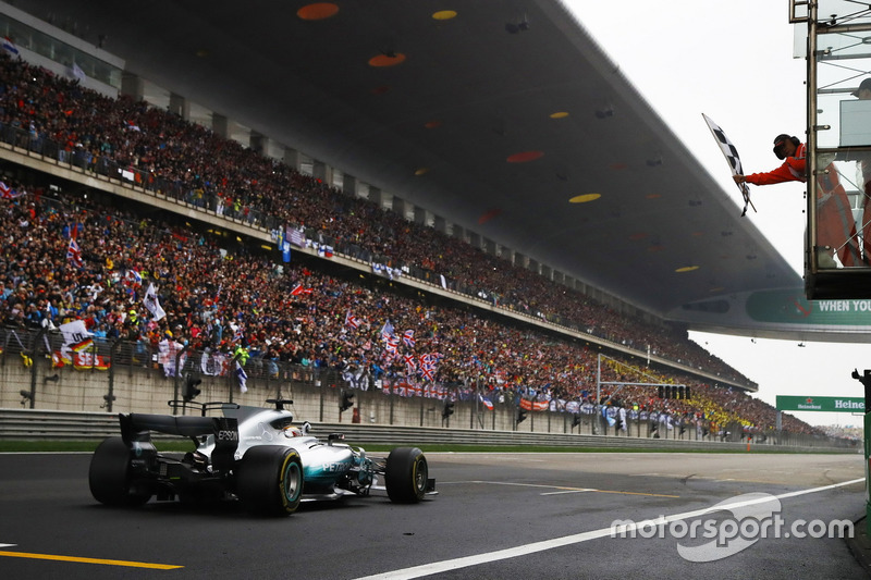 Lewis Hamilton, Mercedes AMG F1 W08, takes the chequered flag