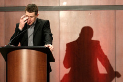 Carl Edwards wipes a tear from his eye as he announces his retirement from NASCAR