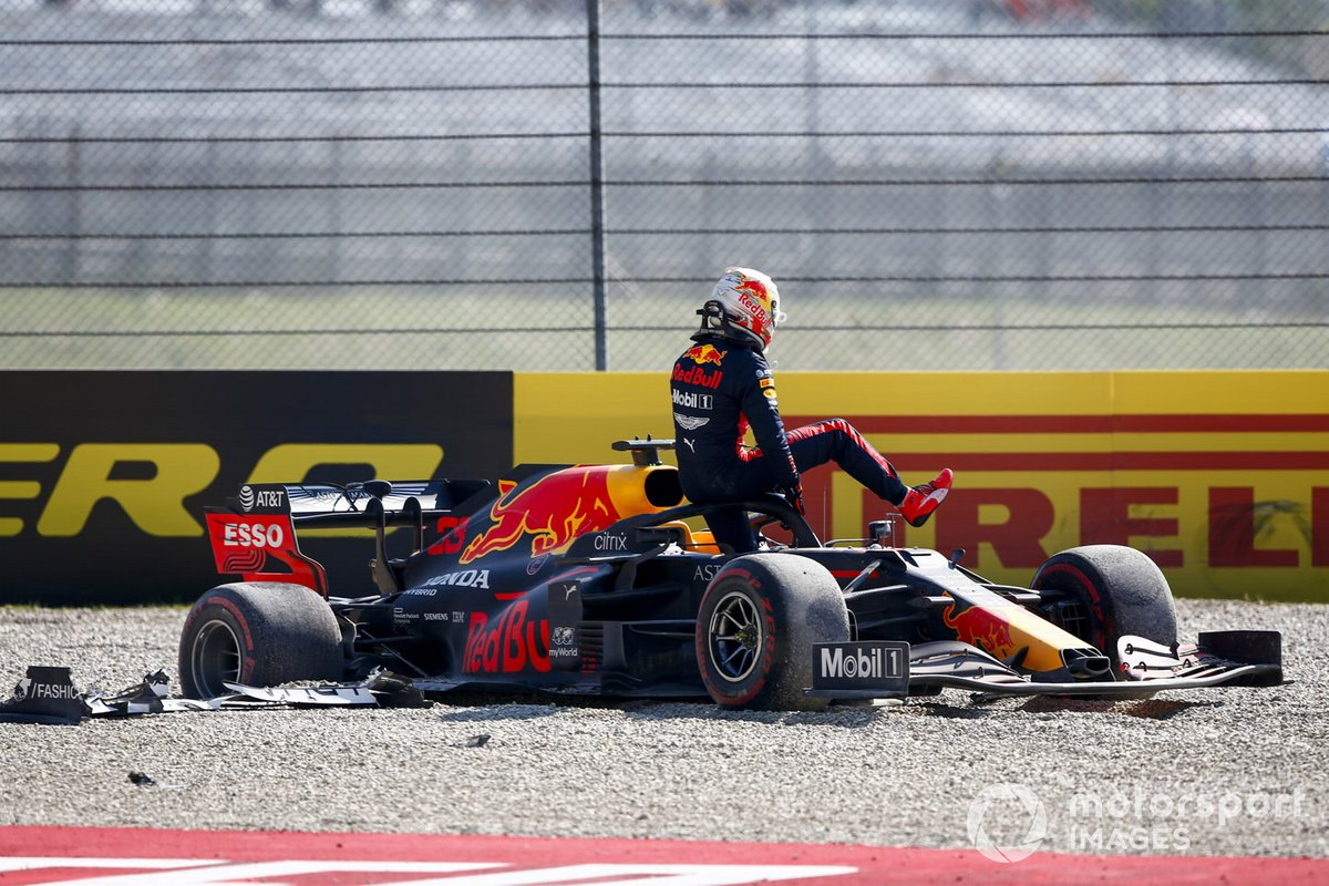 Max Verstappen, Red Bull Racing RB16, climbs out of his car after retiring in a first lap incident