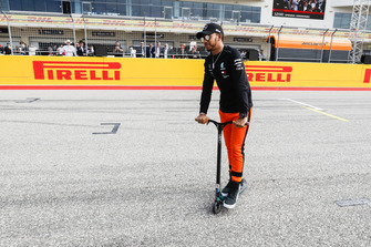 Lewis Hamilton, Mercedes AMG F1, on a scooter on the grid