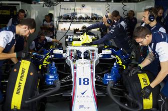 Mechanics work on the car of Lance Stroll, Williams FW41