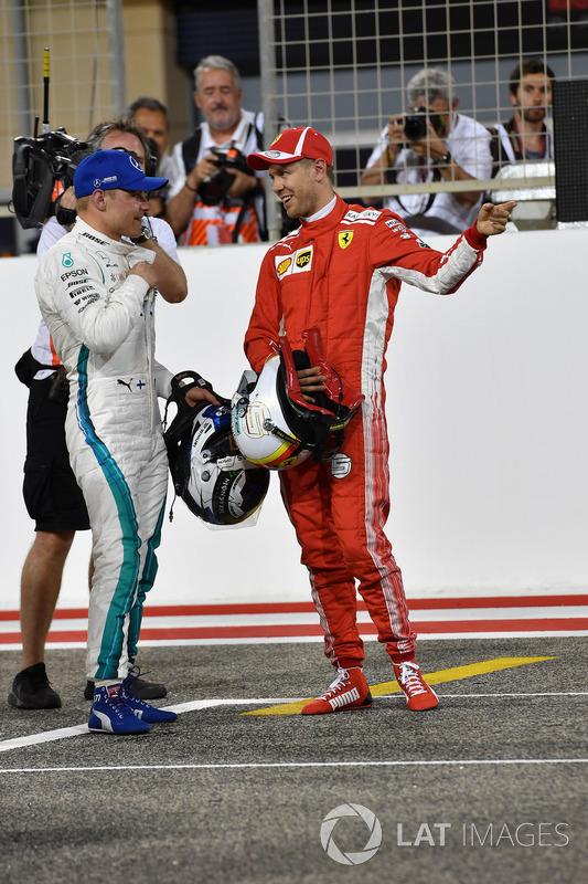 Pole sitter Sebastian Vettel, Ferrari celebrates in parc ferme with Valtteri Bottas, Mercedes-AMG F1