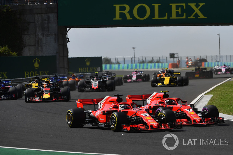 Sebastian Vettel, Ferrari SF71H and Kimi Raikkonen, Ferrari SF71H battle at the start of the race