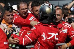 Sebastian Vettel, Ferrari celebrates in parc ferme, the team