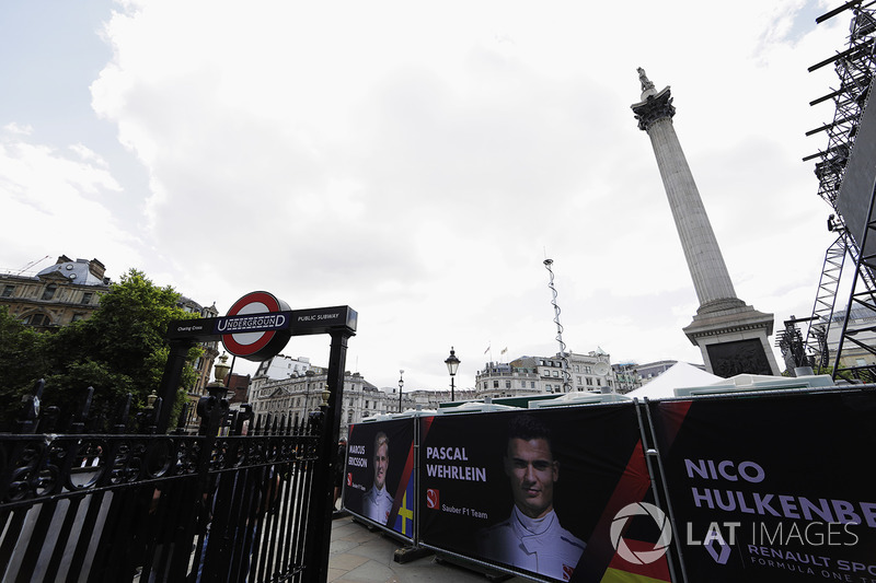 Banners for drivers including Pascal Wehrlein, Sauber, Nico Hulkenberg, Renault Sport F1 Team, around the Underground stairwell and Nelsons Column