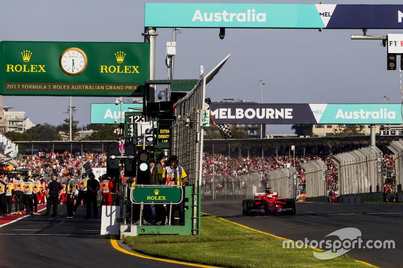 Sebastian Vettel, Ferrari SF70H, takes the chequered flag for victory