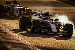 Valtteri Bottas, Mercedes F1 W08, leads Antonio Giovinazzi, Sauber C36
