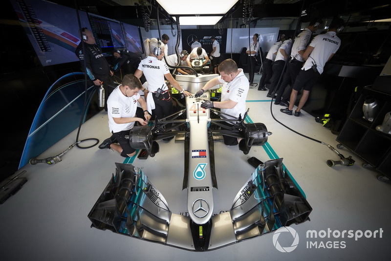 Engineers work on the car of Lewis Hamilton, Mercedes AMG F1 W09