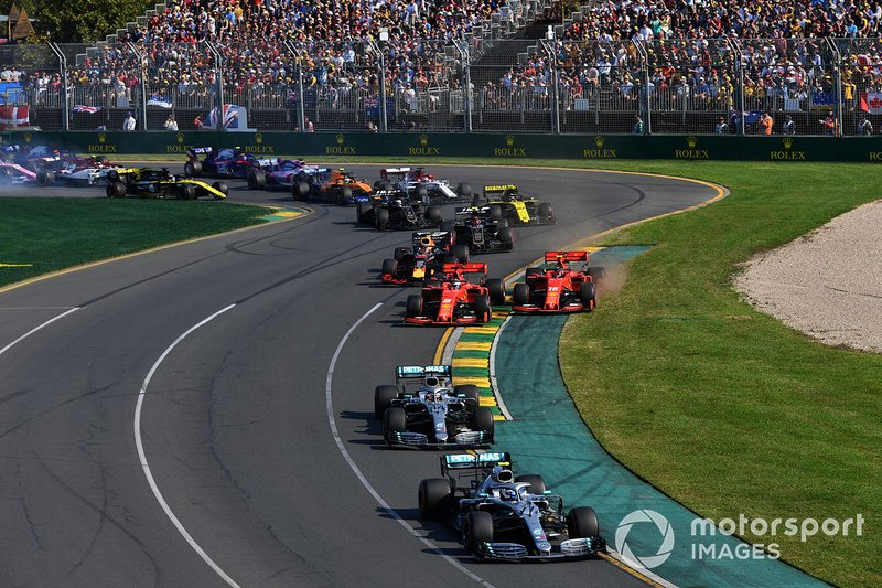 Valtteri Bottas, Mercedes AMG W10, leads Lewis Hamilton, Mercedes AMG F1 W10, Sebastian Vettel, Ferrari SF90, Charles Leclerc, Ferrari SF90, and Max Verstappen, Red Bull Racing RB15, and the rest of the field through the first corner