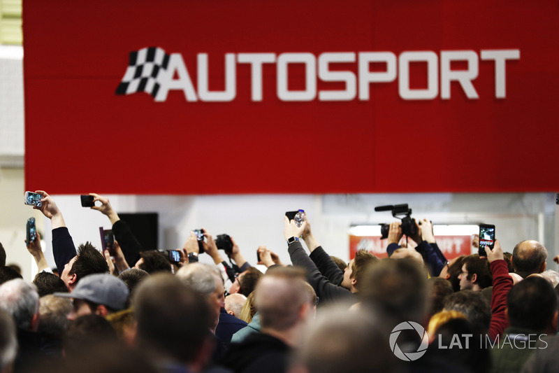 Fans take photos of guests on the Autosport Stage