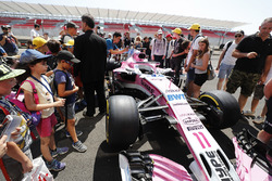 Fans young and old inspect the Sergio Perez Force India VJM11 at close quarters