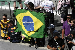 Fan with Brazilian flag at the podium celebrations