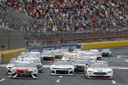 Brad Keselowski, Team Penske, Ford Fusion Stars, Stripes, and Lites Kyle Busch, Joe Gibbs Racing, Toyota Camry M&M's Red White & Blue