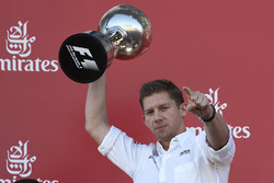James Vowles, Chief Strategist, Mercedes AMG F1, receives the constructors trophy for Mercedes