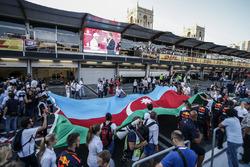 Fans observe podium celebrations, Valtteri Bottas, Mercedes AMG F1 who celebrates on the podium, David Coulthard, the flag of Azerbaijan
