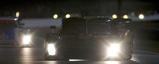 Grand-Am Porsche in early control at Daytona as the sun sets
