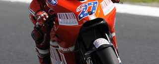 MotoGP Stoner edges Rossi to secure Australian pole