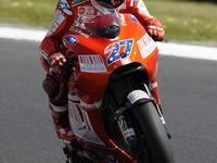 Stoner edges Rossi to secure Australian pole