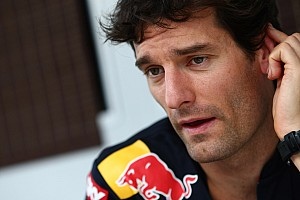 Formula 1 Webber enjoys wheelie on Grand Prix motorbike