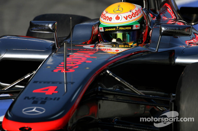 Hamilton takes pole position for season opener in Australia