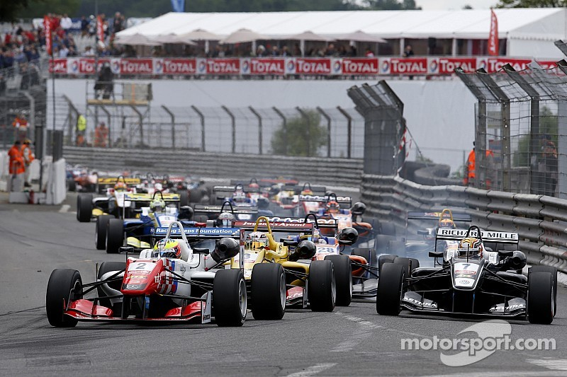 Dennis wins again in crash-strewn race two